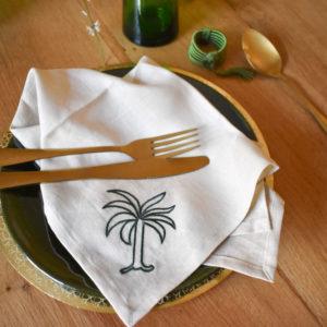 Handmade homeware green table setting dinnerware brass gold underplates and ceramic green plates details