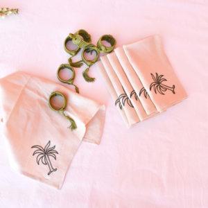 Handmade homeware green table setting dinnerware hand embroided linen napkins and napkin rings