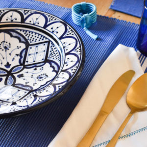 Handmade blue and white table setting dinnerware detail