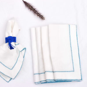 Handmade blue and white table setting dinnerware homeware linen embroidered napkins