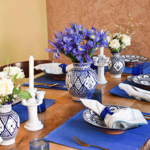 Handmade blue and white table setting dinnerware side view